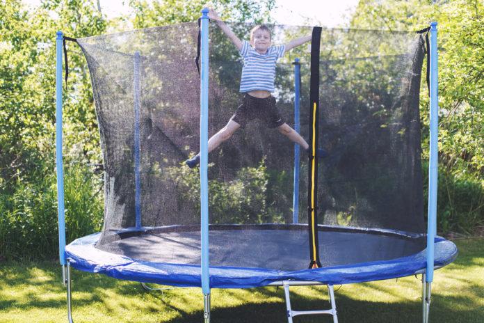 kids trampoline boy jumping